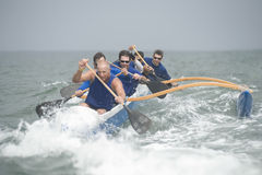 Outrigger Canoeing Team In Race Stock Photography