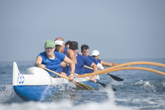 Outrigger Canoeing Team In Race Stock Photos