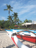Outrigger Canoes on the Resort Beach Royalty Free Stock Photography