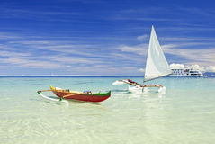 Outrigger canoes on sandy beach Stock Photography