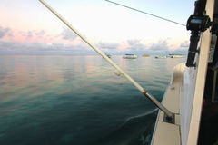 Outrigger while fishing trolling. Outrigger at dawn on the boat while fishing trolling Royalty Free Stock Photography
