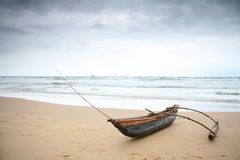 Outrigger Under A Stormy Sky Royalty Free Stock Image