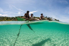 Outrigger and Young Indonesian Islanders Royalty Free Stock Photo