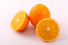 Outro dividido e um da laranja fresca Fotografia de Stock Royalty Free