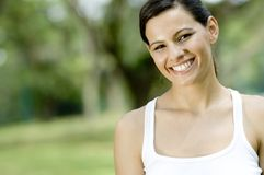 Outside. An attractive young woman standing in a park (shallow depth of field used stock images