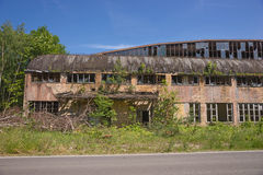 Outside of abandoned factory building Stock Images