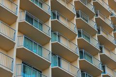 Outside balconies of a hotel or apartment complex Stock Photos