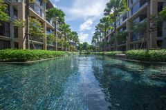 Outside big pool in luxury condominium Stock Images