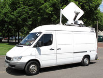 Outside broadcast van. Outside broadcast white media vehicle van Royalty Free Stock Image