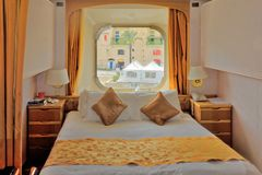 Outside Cabin of Ship. An outside cabin with window on a cruise ship in port Royalty Free Stock Images