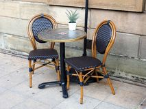 Cafe Table And Cane Framed Chairs. An Outside Cafe Or Coffee Shop Table,  With