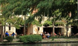 Outside cafe on the Riverwalk in San Antonio stock images