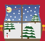 Outside Christmas window. Outside the window a Christmas scene, with Santa Claus his sleigh and reindeer, snow covered trees and a snowman Royalty Free Stock Images