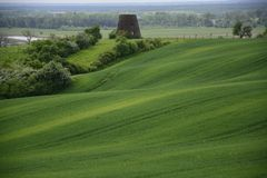 Outside the city - rural landscape - an old windmill on the fiel Stock Image