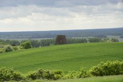 Outside the city - rural landscape - an old windmill on the fiel Stock Photo