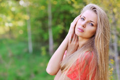Outside close up portrait of beautiful young happy woman with fr Stock Image