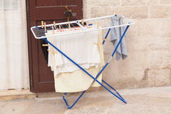 Outside clothes drier left in the street Stock Image