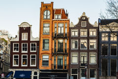 The outside of colorful thin buildings in Amsterdam during the day. Royalty Free Stock Photos