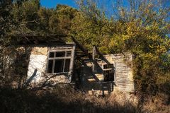 Outside of decaying house stock images