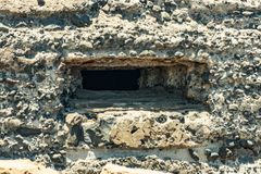 Outside detailed view of loophole of old military bunker on the south coast of El Medano. Tenerife, Canary Islands, Spain.  royalty free stock photography