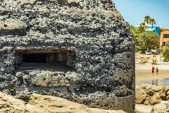 Outside detailed view of loophole of old military bunker on the south coast of El Medano. Tenerife, Canary Islands, Spain stock photography