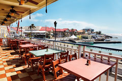 Outside dining. Outside terrace at a restaurant on a quiet day in Georgetown, Grand Cayman Royalty Free Stock Images