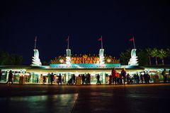 Outside of entrance and exit of California Disney Theme Parks at night with local people and traveler at Anaheim Los Angeles. royalty free stock photography