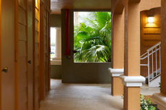Outside hallway with with doors and rain Royalty Free Stock Photo