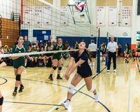 Quick maneuver to keep the ralley going. Outside hitter for West Ranch High School`s freshman/sophomore volleyball team races to retrieve ball on defense as royalty free stock photos