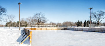 Outside ice rink. On a sunny day with a lot of snow royalty free stock photo