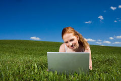 Outside with laptop stock photography