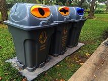 Outside litter bin at the park Stock Image