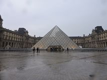 Louvre on a rainy day. Outside the lourve on a grey and rainy fall day in paris/ city of love Royalty Free Stock Photography