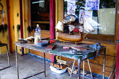 Outside of a model ship craftsman workhouse. The desk of a craftsman's building handmade model ships in Mauritius Royalty Free Stock Photo