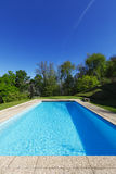 Outside of modern house in summer, swimming pool Stock Image