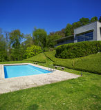 Outside of modern house in summer, swimming pool Stock Photo