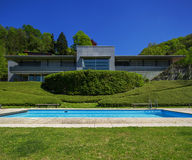 Outside of modern house in summer, swimming pool Royalty Free Stock Photo