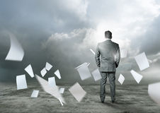 Outside The Office. Business concept - Paperwork flying around a businessman royalty free stock photos