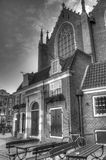 Outside of Oude Kerk church in Amsterdam Netherlands HDR Royalty Free Stock Photo