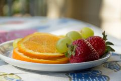 Outside in the Patio. The textures and  the taste of juice Oranges, filling the desire for fresh fruits in the morning. Morning Breakfast Royalty Free Stock Images
