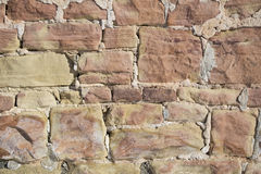Outside red rock wall mortar Royalty Free Stock Photo