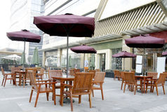 OUTSIDE RESTAURANT. Chairs and dest outside restaurant Stock Photography