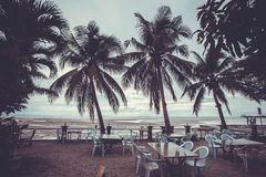 Outside restaurant at the beach in rain time with Royalty Free Stock Photo