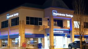Outside shot of Westminster savings at night. In Port Coquitlam BC Canada stock footage