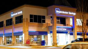 Outside shot of Westminster savings at night. In Port Coquitlam BC Canada stock video footage