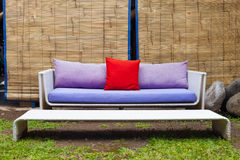 Outside sofa. Stylish sofa placed in garden in tropical climate Stock Images
