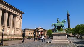 Outside St George`s Hall, Liverpool. An equestrian statue of Queen Victoria outside St George`s Hall in the city centre of Liverpool, England, looking towards Stock Image