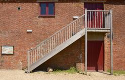 Outside Staircase on old brick wall Stock Photo
