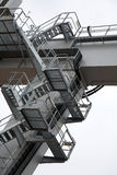 Outside stairway. A steel stairway outside at a plant or construction site Stock Photography