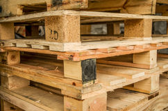 Outside stock of old manufactured wooden standard euro pallets stored in pylons.  Stock Photography